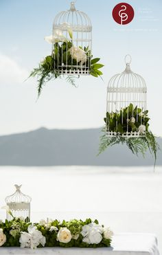 Romantic wedding with birdcages, white roses and hydrangea in Santorini    Flower creations and design: Wedding Wish Santorini | www.weddingwish.com.gr  Wedding Planner: Poema Weddings and Special Events Poema Weddings & Special Events in Santorini - Event Specialists in Greece | www.santoriniweddings.com.gr   Photographer: Studio Phosart | Photograhy & Videography | www.photographergreece.com