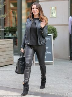 Stylish: To finish off her ensemble, she opted for stiletto ankle boots, which accentuated...