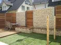Gartengestaltung Gabionen Struktur Natursteine Wand