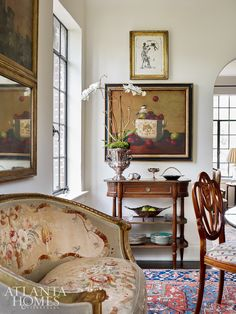 In a dining room by and a carved French settee is covered in an Aubusson tapestry while a bright Oriental rug… Dining Room Sideboard, Harrison Design, Classic White Kitchen, Pillow Room, Atlanta Homes, Settee, Oriental Rug, Decorating Your Home, Living Room