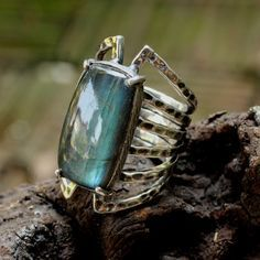 Stunning chunky labradorite ring in oxidized sterling silver band by Sirilak Samanasak of Metal Studio Thailand.  http://metal-studio-thailand.com