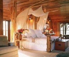 How relaxing. What a lovely idea for guest room- drift wood canopy