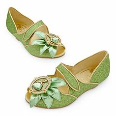 Disney Tiana Shoes for Girls   Disney StoreTiana Shoes for Girls - Fairytale dreams will be on the menu when she plays the role of the southern belle in her glittering green Tiana Shoes. Metallic faux leather leaves are topped with a bejewelled cameo with the royal star of The Princess and the Frog.