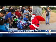 L.A. County Sheriff's department's Annual toy giveaway with the AbilityFirst East Los Angeles Center and Santa arriving by Helicopter.