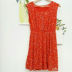 """UO Red Floral Dress Beautiful floral dress with pleats, elastic waist, and functioning buttons. Color is orange-red. In great condition! Brand is blu pepper.  33"""" length  16"""" bust  13"""" waist (elastic) 17"""" hips   100% polyester Urban Outfitters Dresses"""