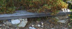 cute garden bench with rock legs