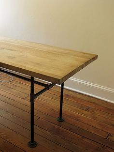 Salvaged wood and plumbing pipe table.