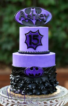 Purple girl power! A girly Batman cake. Follow HoneyLove Cakery on Facebook, twitter, and instagram @HoneyLoveCakery.