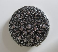Silver yogja powder compact - Indonesia by A window in Amsterdam, via Flickr