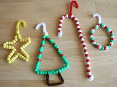 Ornaments...out of Pipe-cleaners ,pony beads and ribbon...all materials that can be found at local arts and crafts store....just twist pipe cleaners into shape that you want...add beads...twist ends of pipe cleaners after last bead is added...attach ribbon to hold the ornament on the tree Handmade Beaded Ornaments