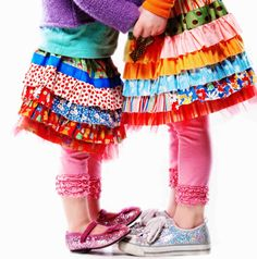 Multi-tiered ruffle joy girls' skirt pattern! Layers of ruffles, a little tulle, a ribbon detail and MILLIONS of ways to embellish and make it your own!! Waw....