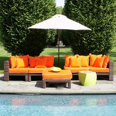 East End Collection Orange -- all-weather ratton modular units in espresso with orange cushions and white piping