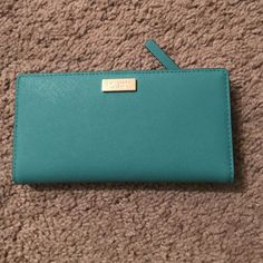 NWT Kate Spade Stacy Wallet This is an authentic Kate spade Stacy wallet in turquoise/Dusty emerald. It has never been used. Price is firm. kate spade Bags Wallets
