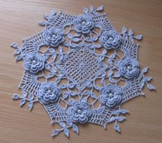 Crochet Roses Ravelry: Blue Rose Doily pattern by Rosanne Kropp. A romantic and delicate crochet piece. Just beautiful. Free Crochet Rose Pattern, Crochet Puff Flower, Crochet Dollies, Crochet Flower Patterns, Crochet Motif, Irish Crochet, Crochet Designs, Crochet Flowers, Free Pattern