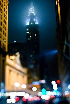 Chrysler Building lit up in the fog by Chris Hallford