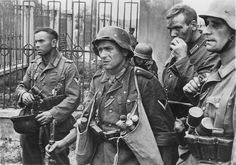 Rostov-on-Don, Russia, July 1942: German grenadiers belonging to 17.Army take a breather during street fighting. The Germans are fighting in winter uniforms. Note the satchels full of stick grenades, the indispensable weapon in street fighting.It is still early in the war and the soldiers are mature men, veterans of previous campaigns. By 1943, this age cohort had been decimated.