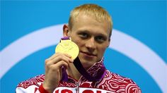 Gold medallist Ilya Zakharov of Russia poses on the podium during the medal ceremony for the Men's 3m Springboard Diving Final on Day 11 s at the Aquatics Centre
