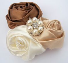 Satin Ribbon Rolled Rosettes. Comes on your choice of hair clip or headband.  Perfect for weddings, prom, picture prop.  Will fit all ages.