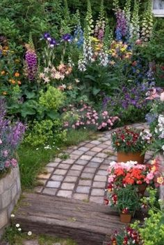 A combination of timber and smaller stone creates a path perfect for this cottage garden. Description from whimsicalhomeandgarden.com. I searched for this on bing.com/images