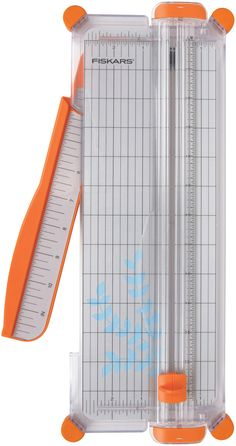 FISKARS-SureCut Paper Trimmer. Fiskars patent pending SureCut wire cut-lin allows you to see the cut before you make it to ensure perfect placement and results. It features the Triple Track rail syste
