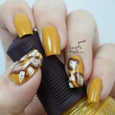 One stroke autumn nail art. Used: SpaRitual Positive Vibe as a base colour and then brown and white acrylic paint. Lucy's Stash.