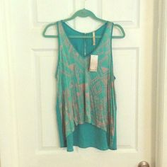 Lovemarks, teal and grey top size large, SOLD This is a great top paired with your favorite jeans or pant and your set. US made rayon stretchy Aztec print on the front with coordinating solid teal none stretch on the back. Tops
