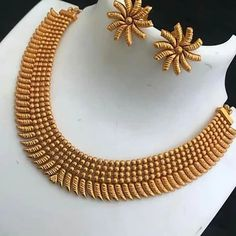 Product Highlights Fantastic Gold Antique Necklace Set Delivery: Dispatched in working days Cash On Delivery: Available Material: Antique and Gold Plated Color: Gold Care: Avoid direct contact with perfume, makeup and other cosmetic products Model Number: Latest Necklace Design, Jewelry Design Earrings, Gold Jewellery Design, Necklace Designs, Fancy Jewellery, Antique Jewellery, Jewelry Art, Gold Jewelry, Short Necklace