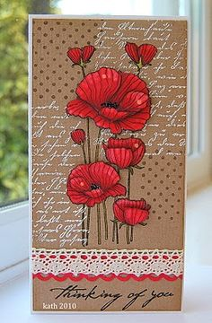 hand made card from Kath's Blog......diary of the everyday life of a crafter ... tall and thin (#10) format ... brilliant red poppies on a kraft card ... luv the vivid coloring with lots of depth ... like the background blocks of white stamped script and black stamped polka dots ... crochet lace ribbon ... fabulous card ... Hero Arts ...