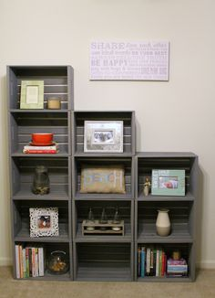 Wooden boxes from JoAnn Fabrics, stained in a light grey wood stain, and stacked up to provide storage and an attractive display of home decor.