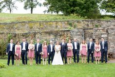 A Red Maple Vineyard wedding party with the bridal party in dusty rose dresses and groomsmen in navy. Photo by NYC wedding photographer Mikkel Paige Photography. #weddingparty #bridalparty #blueandpinkwedding