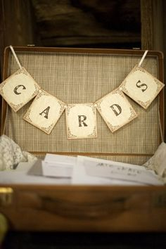 """A vintage suitcase adorned with rustic bunting spelling """"Cards"""" was used to collect guest's cards. Rustic New York Real Wedding 