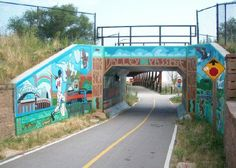 Hank Aaron began his major league baseball career with the Milwaukee Braves in the 1950s, and Milwaukee's Menomonee River Valley bicycling/hiking trail is named after him. The mural on the left-hand side of this underpass depicts him from that Braves era. West Milwaukee, WI. (Richard S. Buse photo)