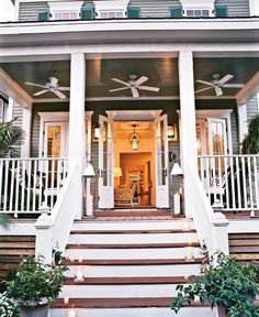 House Exterior/Front Porch. Like the symmetry, the three fans, the brown and white steps