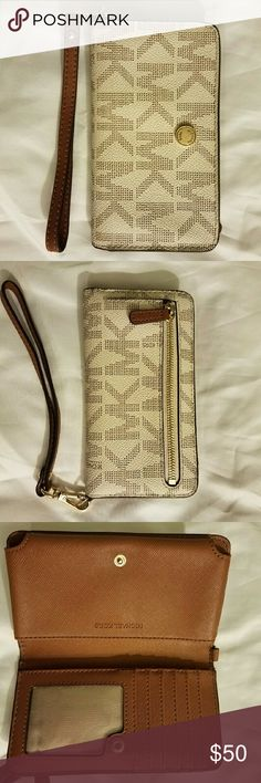 Michael Kors Vanilla wristlet/phone case Michael Kors Vanilla Signature wristlet/phone case in excellent condition with  minor cracking as seen in pic. Michael Kors Bags Clutches & Wristlets
