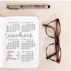 habit tracker in a minimal bullet journal