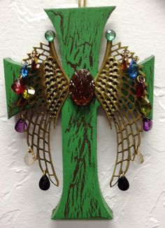 Wooden cross, Elmer's glue to crackle paint, and a pair of angel wings earrings.