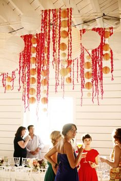 Ceiling/Height Decor - drape paper pom-poms, chinese lanterns and twisted crepe paper streamers over wooden dowel rods. This could be used for any special occasion by changing out the colors.