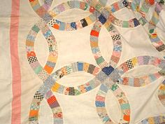 My grandmother made a quilt similar to this with fabric from dresses she wore as a kid.