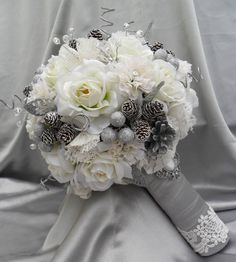 white and silver bouquet - like the texture in this with the frosted pine cones-  for a bridal bouquet