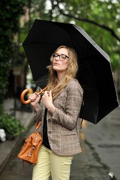 i like the sophisticated quirky look! This pose with umbrella will make my clothing look like it fits into every day life