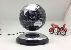 Magnetic Levitation Globe Creative Business Office Desk Ornaments New Magical Rotation Floating Ball Fashion Plastic Crafts - http://www.aliexpress.com/item/Magnetic-Levitation-Globe-Creative-Business-Office-Desk-Ornaments-New-Magical-Rotation-Floating-Ball-Fashion-Plastic-Crafts/32272605523.html