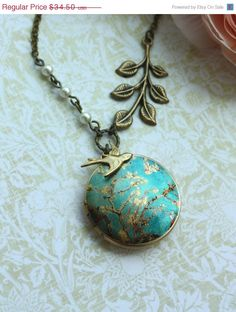 ON SALE A Japanese Spring Cherry Blossom, Brass Leaf , Flying Swallow Bird, Altered Art Image Photo Brass Locket Necklace.  Unqiue. Made In