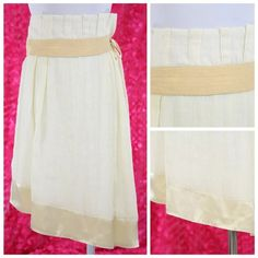 """PeopleLike Frank Asymmetric Ivory Linen Skirt 33"""" People Like Frank is a line designed by Emil Rutenberg out of Los Angeles.  It is only carried in upscale boutiques throughout the world.   Beautiful and versatile ecru color with a pastel yellow satin band.  High waist.  The waist line is where the satin tie band is.  100% linen and fully lined.  Perfect for year round wear.  People Like Frank runs on the generous side of sizing.  Waist 33"""" at the band and 30"""" above band  Hip 40""""  Length of…"""