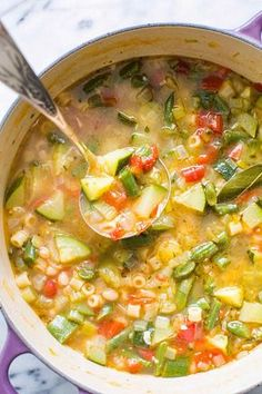 Minestrone soup featuring fresh summer garden vegetables! With zucchini, tomatoes, green beans, celery, bell pepper, chicken stock, white beans, and pasta. It's summer in a soup! On http://SimplyRecipes.com