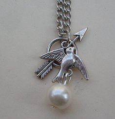 The Hunger Games ,Inspired Mockingjay ,peeta's pearl,tree,bow and Arrow Necklace -antique SILVER or brass