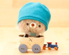 Nimu is a small amigurumi crocheted and sewed teddy bear. He is made of mohair and yarn with safety eyes and stuffed with polyfil.
