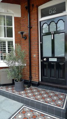 I definitely won't be buying a house like this, but I do love the mosaic flooring - Victorian porch doorway wall tiles Front Path, Front Door Steps, Front Door Porch, Porch Steps, Victorian Front Garden, Victorian Front Doors, Victorian Porch, Victorian Windows, Porch Tile