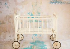 Vintage Antique Cream Doll Crib on wheels- Photo Prop. $45.00, via Etsy.    Looks very much like my Mother's doll crib which I played with.  Her's was pastel green.