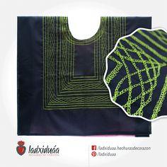 Huipil sencillo negro, con tejido de cadenilla en hilo verde olivo.