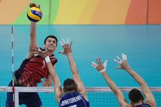 USA's Matthew Anderson spikes the ball during a